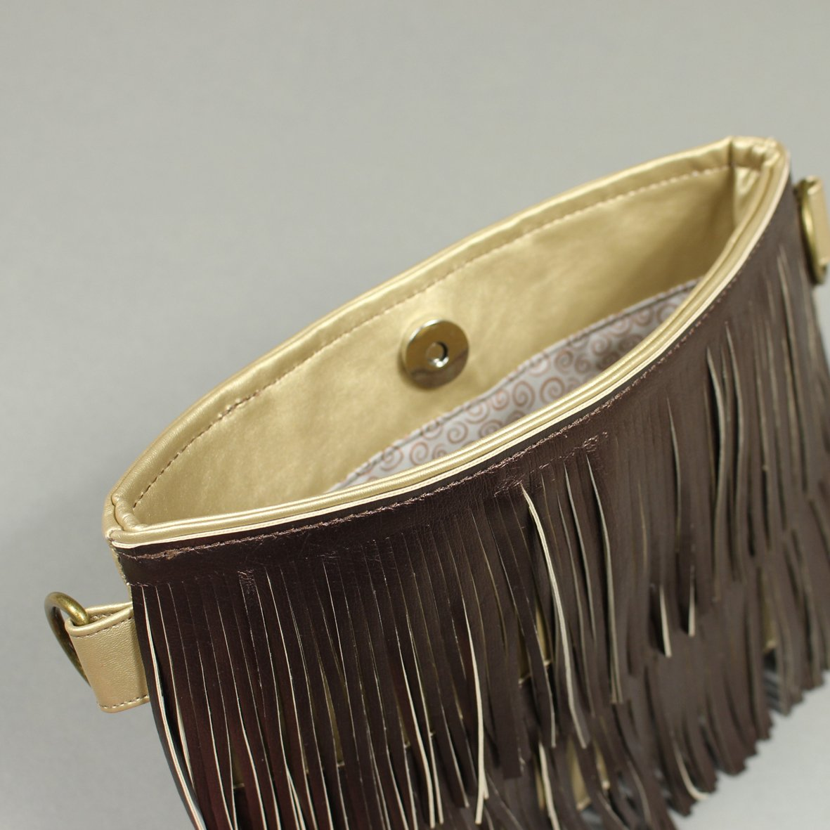 Fringed faux leather shoulder bag detail