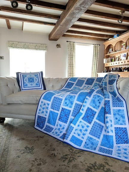 Blue Brick Quilt on sofa