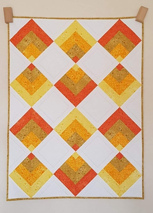 Sharon Devanney Orange Cot Throw Point on Point quilt