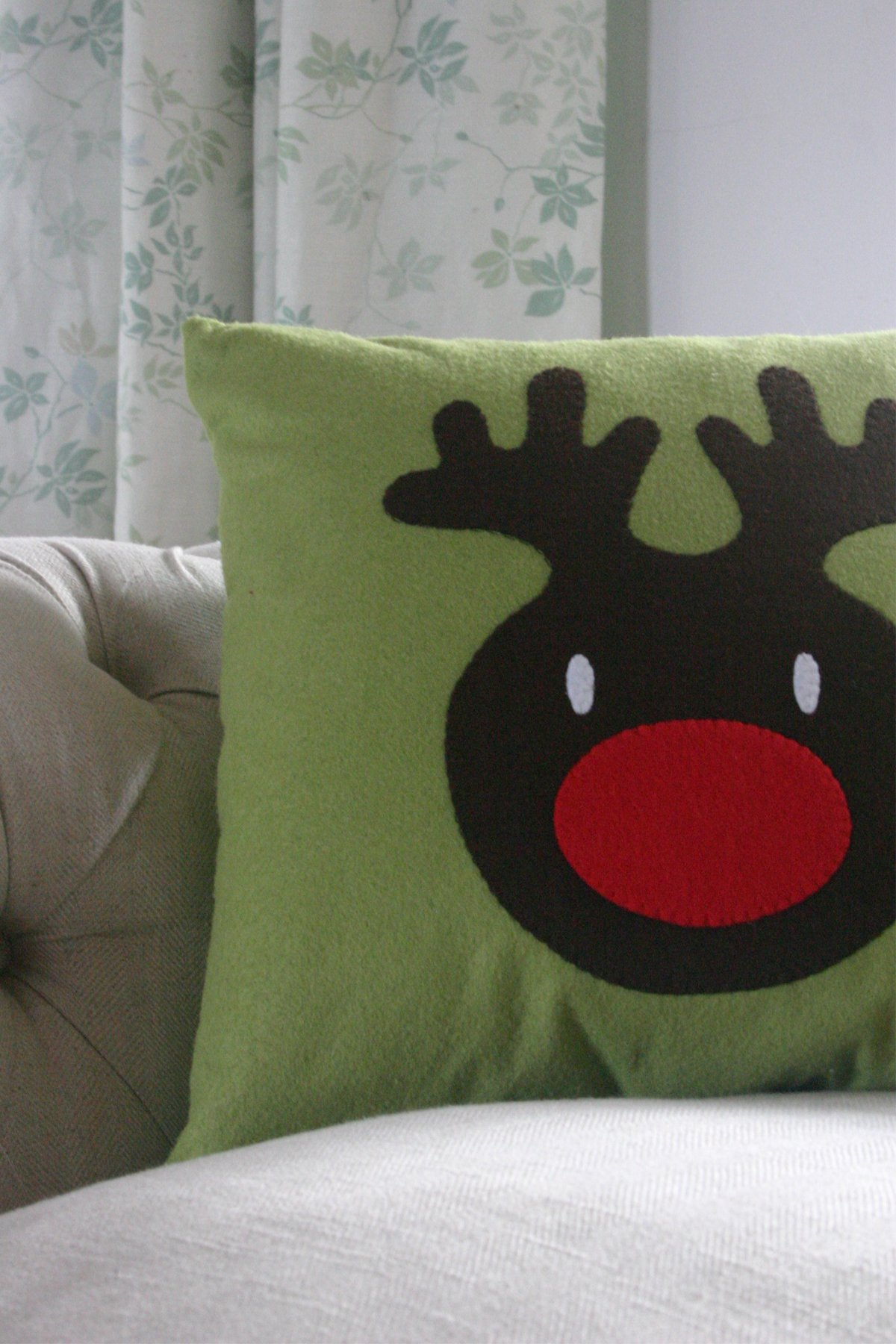 Reindeer Cushion on a sofa