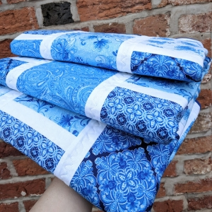 Blue brick quilt in hand