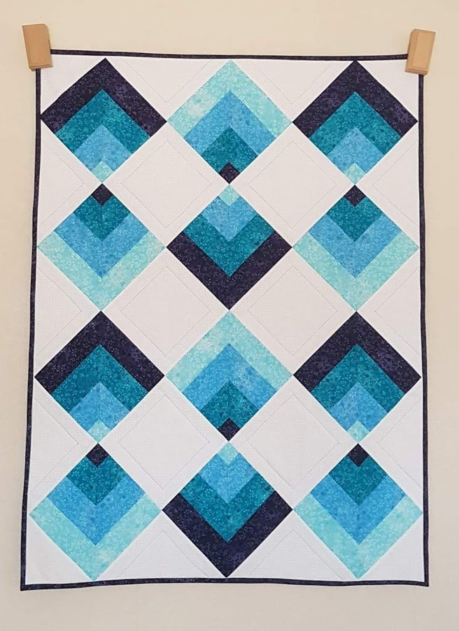 Sharon Devanney Blue Cot Throw Point on Point quilt