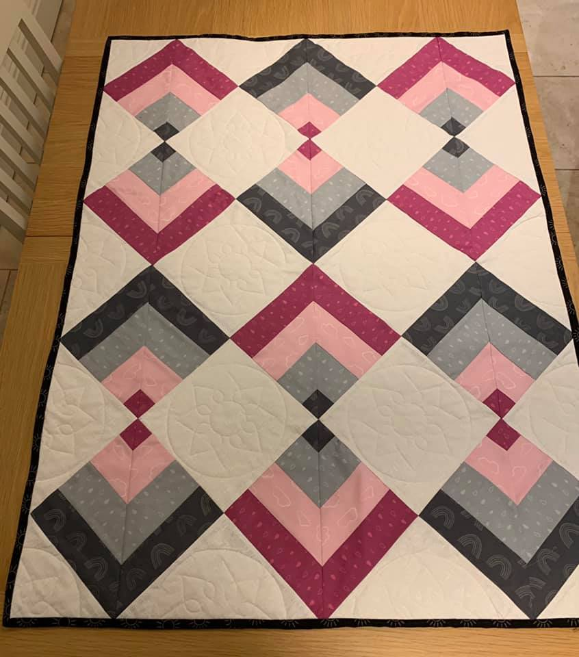 Sue Carrier Cot size finished Point On Point quilt