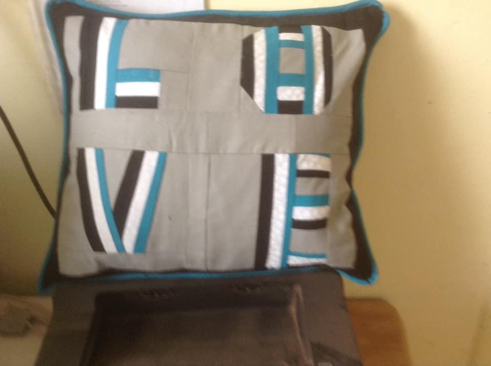 Christine Ann Plumridge LOVE cushion in football stripes